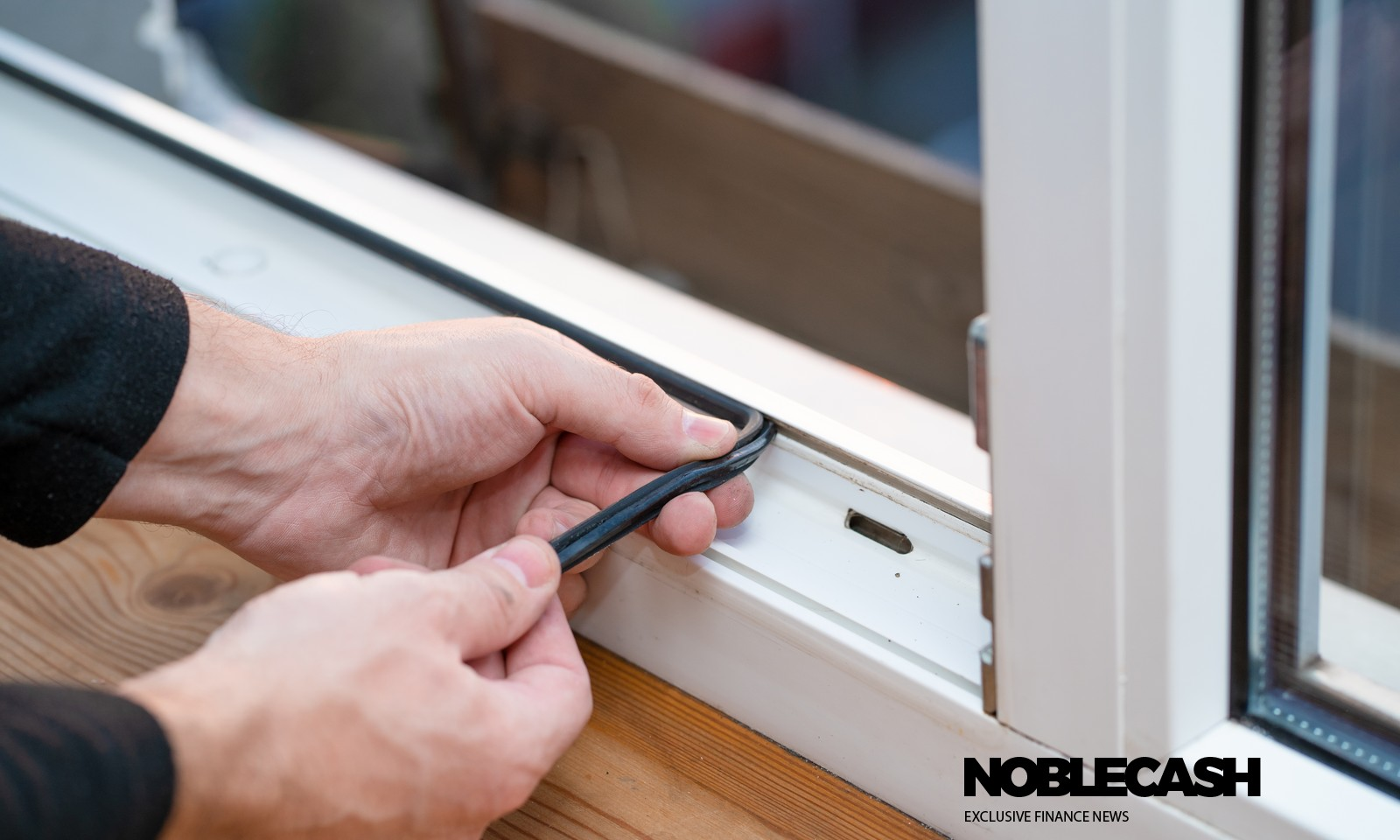 Professional master at repair and installation of windows, changes rubber seal gasket in pvc windows