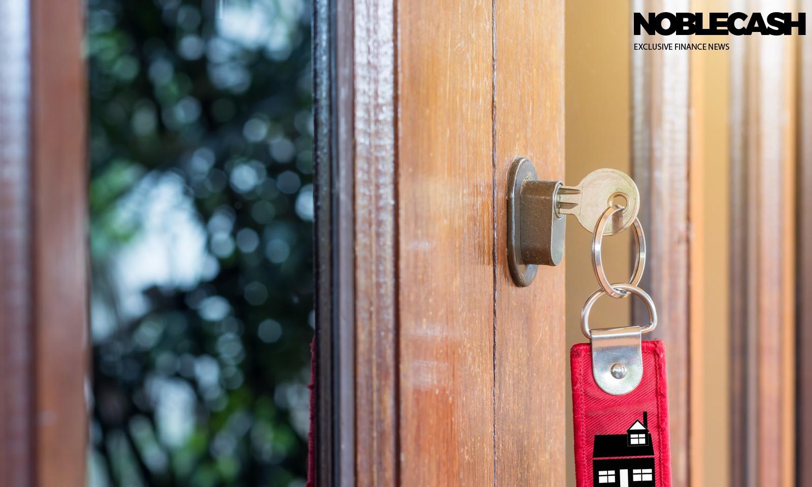 Key on hand of people open the door to inside ,outside door open
